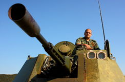 Soldier on military armored vehicle stock images