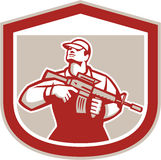 Soldier Military Serviceman Holding Assault Rifle Crest Retro. Illustration of an American soldier serviceman holding assault rifle looking up set inside shield Stock Photos