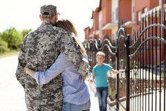 Soldier in military uniform with his family, outdoors. Soldier in military uniform with his family outdoors royalty free stock image