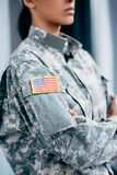 Soldier in military uniform with usa emblem. Cropped view of african american female soldier in military uniform with usa flag emblem Stock Photography
