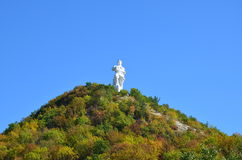 Soldier monument. A large granite monument to fallen soldiers Artem on the mountain, surrounded by forests on the shores of the picturesque deep river Stock Image