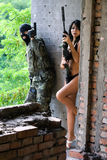 Soldier and naked woman. Soldier and naked scared woman in ambush stock images