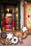 Soldier nutcracker statue standing in front of a decorated Christmas window Royalty Free Stock Images