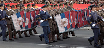 Soldier with old Serbian army flags Royalty Free Stock Image