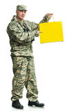 Soldier with a package Royalty Free Stock Photography
