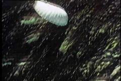 Soldier parachuting from military plane stock video footage