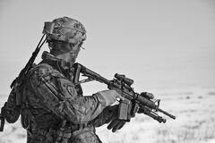 Soldier on patrol with rifle Stock Image