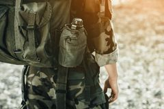 The soldier in the performance of tasks in camouflage. War Zone stock photos
