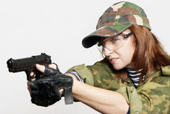 Soldier with a pistol in hands Stock Photography