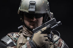 Soldier with pistol Stock Image