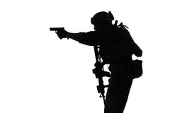 Soldier with pistol. United states Marine Corps special operations command Marsoc raider with weapon aiming pistol. Silhouette of Marine Special Operator white Stock Image