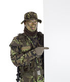 Soldier pointing finger to white blank board Stock Photo