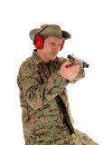 Soldier pointing a pistol. Royalty Free Stock Images