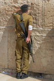 Soldier praying. A soldier praying at the wailing wall royalty free stock photos