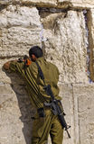 Soldier Praying at The Western Wall. Israeli soldier praying at the Western Wall in Jerusalem stock image