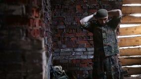 The soldier prepares uniforms. The soldier prepares his uniform, prepares for battle stock video footage