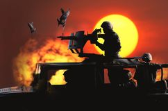 Soldier preparing to aim machine gun mounted on the roof of Humvee. Background of the war scene in which the bomber royalty free stock photo