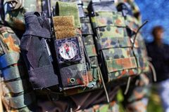 Soldier protection vest with magazines and other tools stock photography