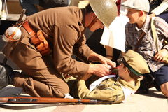 Soldier providing medical aid