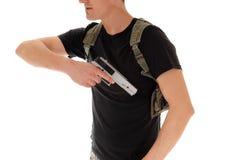 Soldier pulling his handgun. Stock Photo
