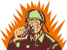 Soldier pulling pin hand grenade Royalty Free Stock Photo
