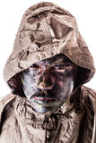 Soldier with raincoat. A soldier wearing a poncho or raincoat and army camouflage face paint isolated over a white background Royalty Free Stock Photos