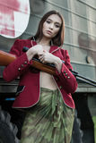Soldier in the red jacket and skirt. Royalty Free Stock Image