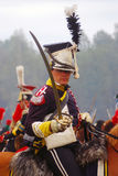 Soldier-reenactor holds a small sword Stock Image