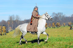 A soldier-reenactor rides a white horse Royalty Free Stock Photography