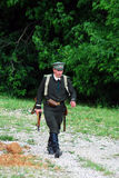 A soldier-reenactor walks on the battle field. Royalty Free Stock Photos