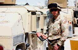 A soldier refueling a militay vehicle Royalty Free Stock Image