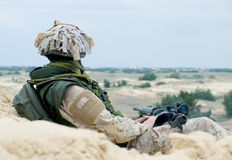 Soldier at rest. Soldier in desert uniform at rest Royalty Free Stock Photo