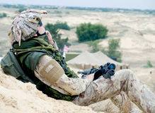 Soldier at rest. Soldier in desert uniform at rest royalty free stock photography