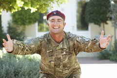 Soldier Returning Home Extending Arms In Greeting Royalty Free Stock Photography