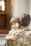 Soldier Returning Home And Greeted By Son Stock Photo