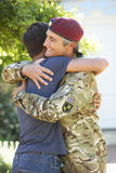 Soldier Returning Home And Greeted By Teenage Son royalty free stock image