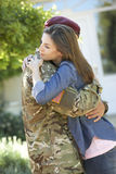 Soldier Returning Home And Greeted By Wife stock image