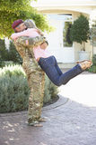 Soldier Returning Home And Greeted By Wife Stock Photos