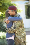 Soldier Returning Home And Greeted By Wife Stock Photography