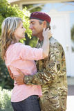 Soldier Returning Home And Greeted By Wife royalty free stock photo