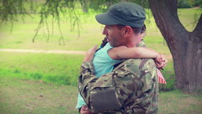 Soldier reunite with his daughter. In park stock video footage