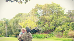 Soldier reunite with his son. In park stock footage