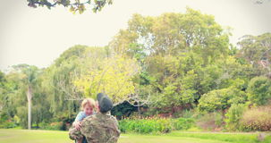 Soldier reunite with his son. In park stock video