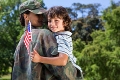 Soldier reunited with her son. On a sunny day Royalty Free Stock Photography