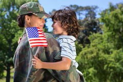 Soldier reunited with her son. On a sunny day Royalty Free Stock Photos