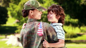 Soldier reunited with her son. On a sunny day stock footage