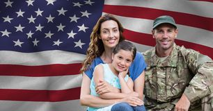 Soldier reunited with his family. Against american flag background stock image