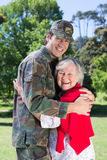 Soldier reunited with his mother. On a sunny day Royalty Free Stock Images