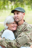 Soldier reunited with his mother. On a sunny day Stock Photo