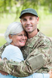 Soldier reunited with his mother. On a sunny day Royalty Free Stock Image